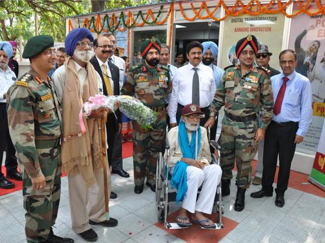 Lt Gen KJ Singh honouring Naik Saroop Singh (retd) at Chandimandir on Friday.