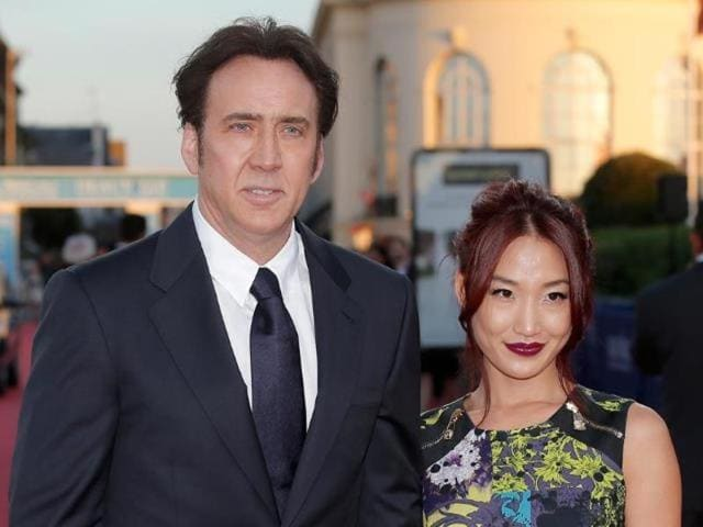 Cage met Kim, 32, in February 2004 when she served him while working as a waitress in a Los Angeles restaurant.