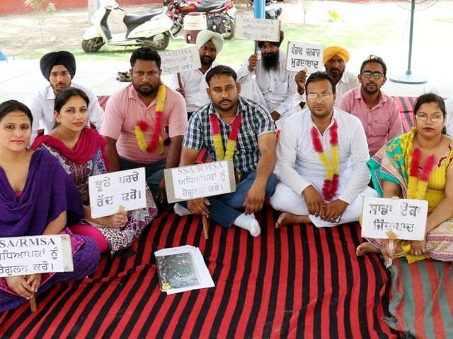 Teachers sitting on a hunger strike at Children Park in Bathinda on Friday.