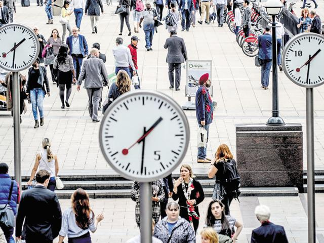 Clocks in the Canary Wharf district of London, June 23, 2016. Britons voted on Thursday on whether to leave the European Union or stay. (Andrew Testa/The New York Times)
