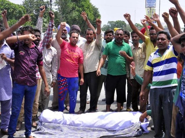 The family members of deceased Ravi Kumar protesting against Punjab Police in front of Rajindra Hospital in Patiala on Friday.