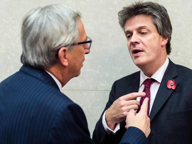 European Commission President Jean-Claude Juncker, left, talks with EU Commissioner for Financial Stability, Financial Services and Capital Markets Union Jonathan Hill.