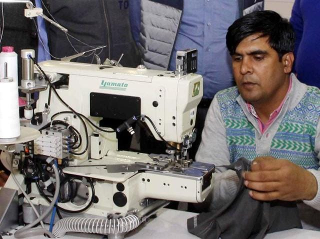 An attendant demonstrating the functionality of a sewing machine in Ludhiana on Friday.
