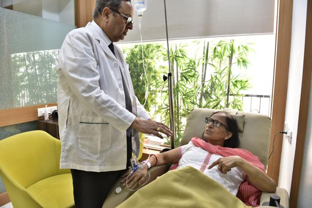 Oncologist Dr Pramod Kumar Julka talks to a patient at Max Healthcare's new day-care chemotherapy centre, which also organises events and counselling sessions for patients and their families.