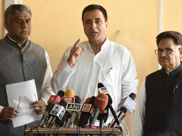Congress leader Randeep Singh Surjewala (centre) interacts with journalists in New Delhi.
