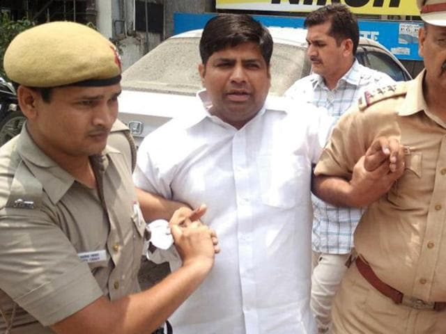 AAPMLA Dinesh Mohaniya after his arrest from his Khanpur office on Saturday.