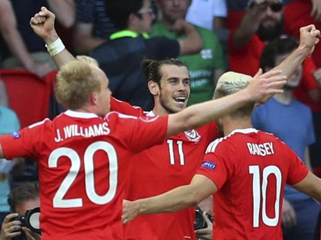 Wales' Gareth Bale celebrates with Wales' Aaron Ramsey after Northern Ireland's Gareth Mcauley scored an own goal during the Euro 2016.