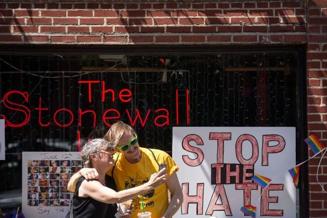 """People take 'selfies' in front of the Stonewall Inn. President Barack Obama designated the inn and approximately 7.7 acres surrounding it as the first national monument dedicated """"to tell the story of the struggle for LGBT rights.""""(AFP)"""