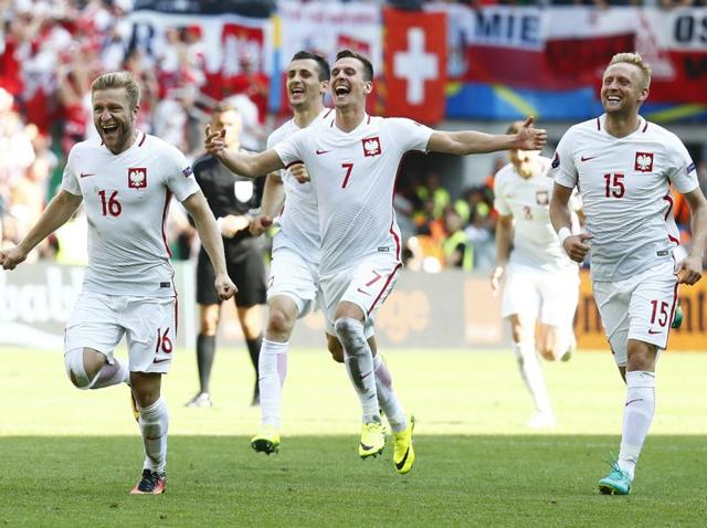 Poland's Jakub Blaszczykowski, Arkadiusz Milik and Kamil Glik celebrate winning the penalty shootout.