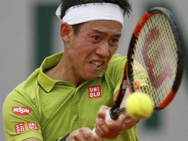 Japan's Kei Nishikori returns the ball in his fourth round match of the French Open tennis tournament.