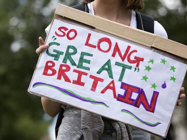 A demonstrator holds a placard during a protest against the pro-Brexit outcome of the UK's June 23 referendum on the European Union (EU).