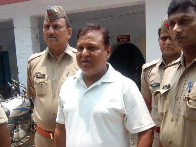 Arun alias Dabbu Tiwari in police custody in Varanasi on Sunday.