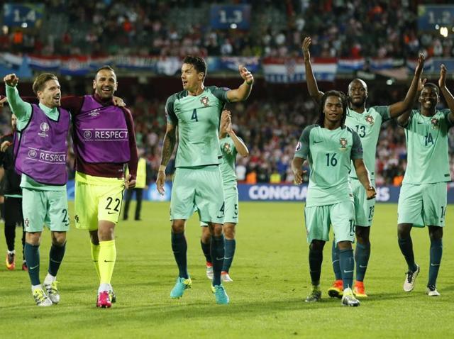 Ricardo Quaresma celebrates after heading in Portugal's winning goal.