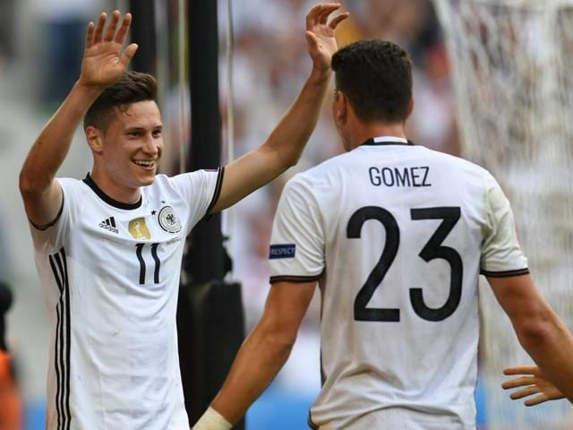 Germany's forward Mario Gomez (C) celebrates with  Julian Draxler and  Thomas Mueller (R).