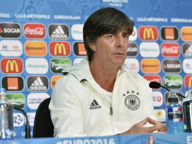 Joachim Loew, centre, talks to the players during a training session on the eve of the Slovakia clash.