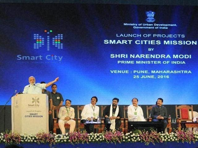 Prime Minister Narendra Modi delivering his address at the launch of the projects, SMART CITIES MISSION, in Pune on Saturday.