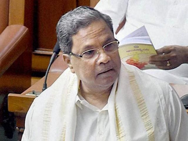 A woman placed a peck on Karnataka Chief Minister Siddaramaiah's cheek at a public meeting here on Sunday, leaving him visibly embarrassed.