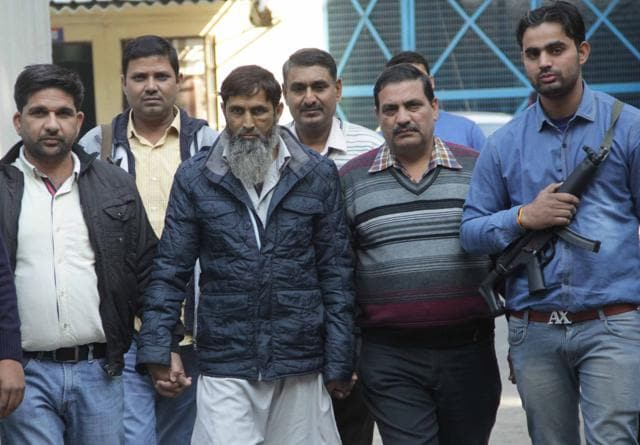 Mohammad Asif (centre), a suspected member of Al-Qaeda in the Indian Subcontinent (AQIS) arrested by the Delhi Police Special Cell.