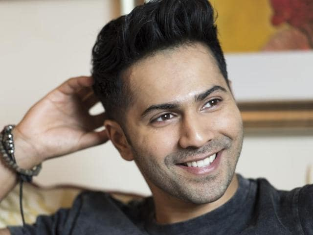 Varun Dhawan's father, David Dhawan, has advised his on to watch Amitabh Bachchan's world tour videos before he leaves for his first-ever world tour.