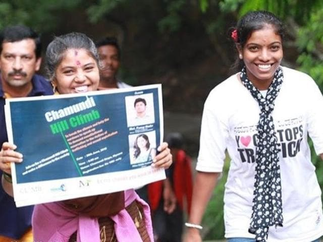 Activists going up Chamundi Hills in Mysuru hold up a poster during the first 'Climb Against Sexual Abuse' campaign in India. Rape survivors across 17 countries are using mountains as a metaphor to inspire others to overcome the odds and speak out.(Photos by Flashbulbzz Photography)