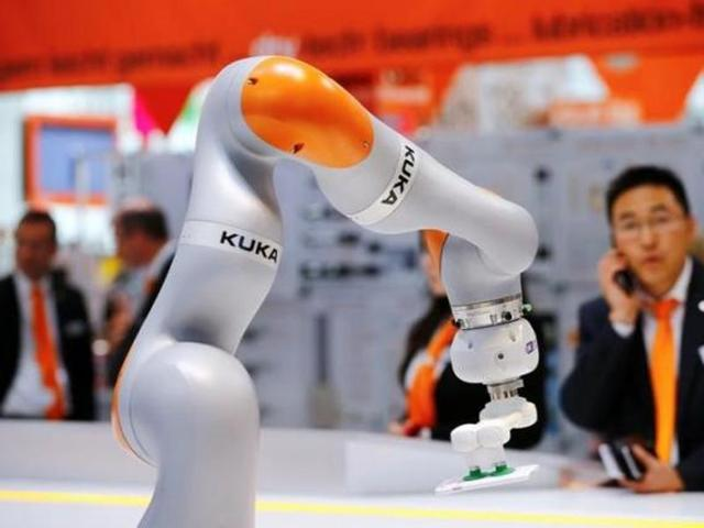 A robot arm of German industrial robot maker Kuka is pictured at the company's stand during the Hannover Fair in Hanover, Germany.