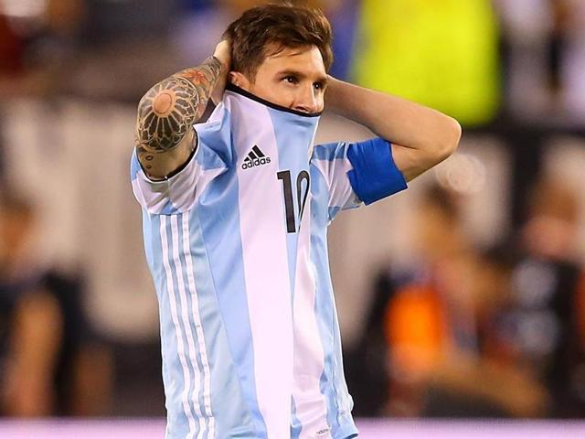 Lionel Messi  reacts after missing a penalty kick against Chile.