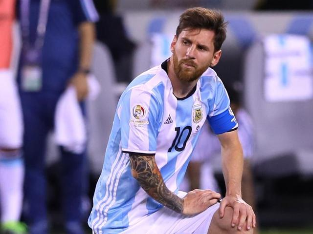 Messi reacts after missing a penalty.