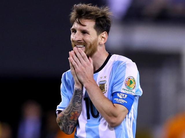 A disappointed Messi walks back after missing a penalty during the penalty shootout.