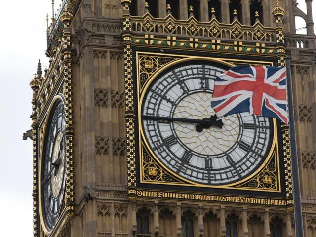 A Union flag is seen flapping in the wind in front of one of the faces of the Great Clock atop the landmark Elizabeth Tower that houses Big Ben at the Houses of Parliament in London on June 27, 2016.