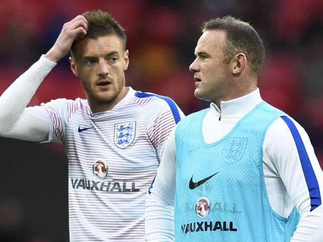 England's Jamie Vardy and Wayne Rooney warm up before the match.