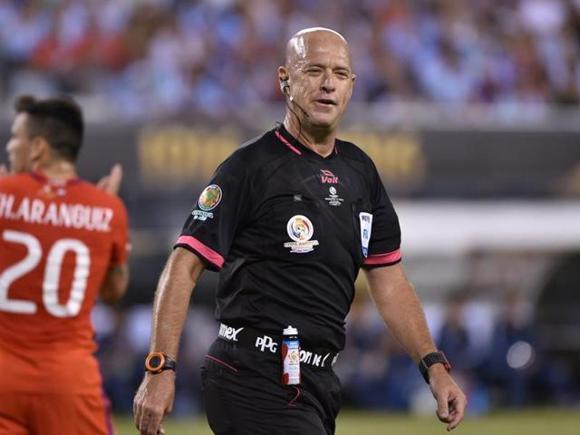 Referee Heber Lopes shows a red card for Argentina .