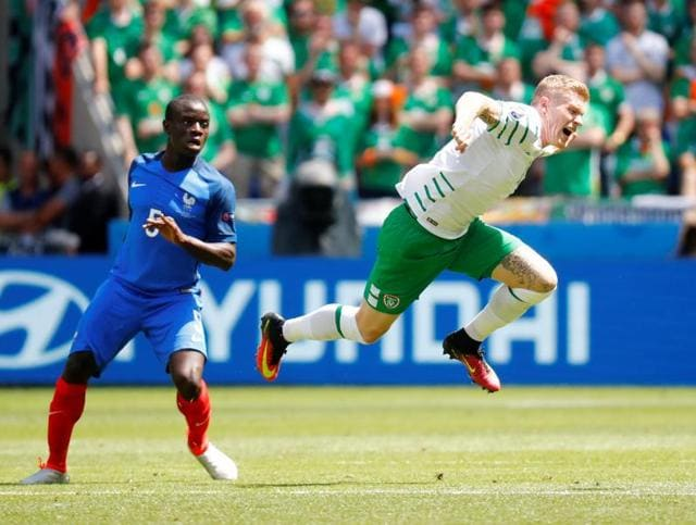 France's forward Antoine Griezmann (top) celebrates scoring a second goal with team mates during the Euro 2016 round of 16 football match between France and Republic of Ireland.