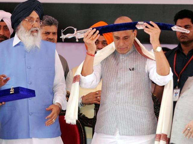 Union home minister Rajnath Singh with a sword presented to him by CM Parkash Singh Badal at a function to mark the 300th martyrdom day of Banda Singh Bahadur at Fatehgarh Sahib on Sunday.