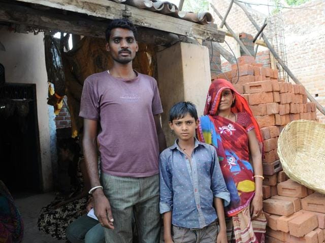 Ramesh with his wife Ram Bai and eldest son Rahul in Nanpur town of Alirajpur district.