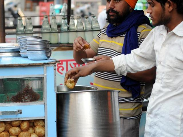 A street vendor serving golgappas without wearing gloves in Patiala on Sunday.