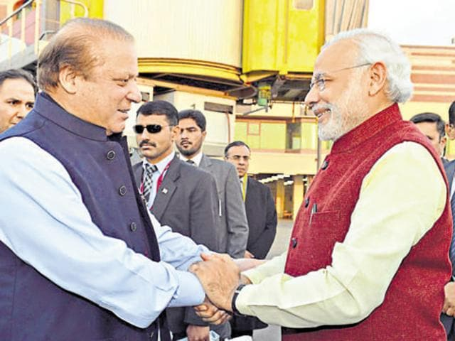 Prime Minister Narendra Modi is received by Pakistani counterpart Nawaz Sharif in Lahore on December 25, 2015.