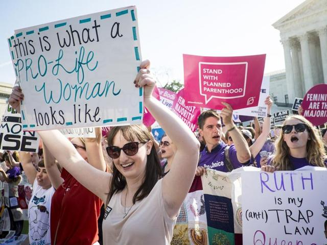 Pro-choice activists celebrate on the steps of the US Supreme Court in Washington on Monday. In a 5-3 decision, the Supreme Court struck down one of the nation's toughest restrictions on abortion, a Texas law that women's groups said would have forced more than three-quarters of the state's clinics to close.