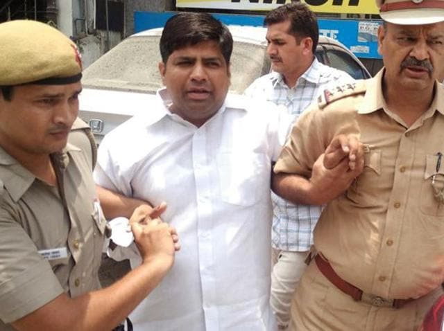 Aam Aadmi Party MLA Dinesh Mohaniya after his arrest on Saturday.