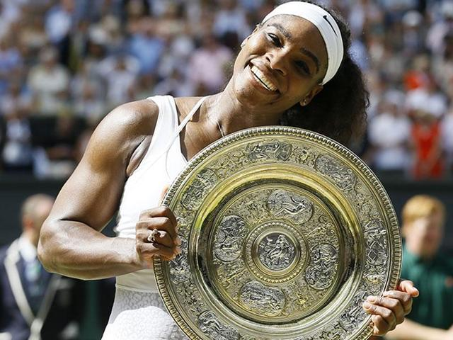 A file photo of Serena Williams of the United States holding the Venus Rosewater Dish, the winner's trophy.