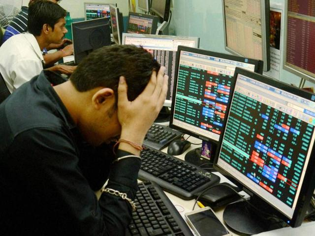 Share brokers react to falling stock prices on screens of computers and television in Kolkata on Friday, June 24, 2016. BSE Sensex plunged down nearly 1000 points and NSE Nifty fell down below 7,950 following Brexit.