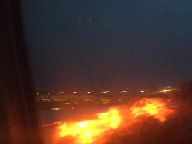 This image provided by Lee Bee Yee shows an engine on fire on a Singapore Airlines flight on Monday, June 27, 2016. A Singapore Airlines statement said the Boeing 777-300ER was on its way to Milan when it turned back