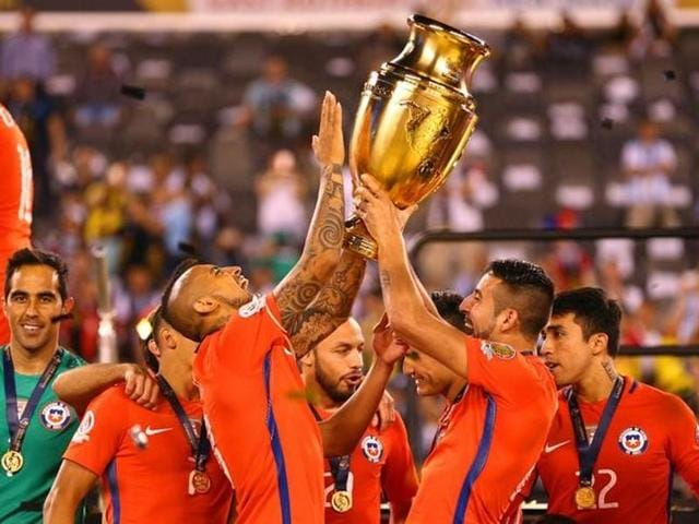 Chile players hoist the championship trophy after winning the 2016 Copa America Centenario.
