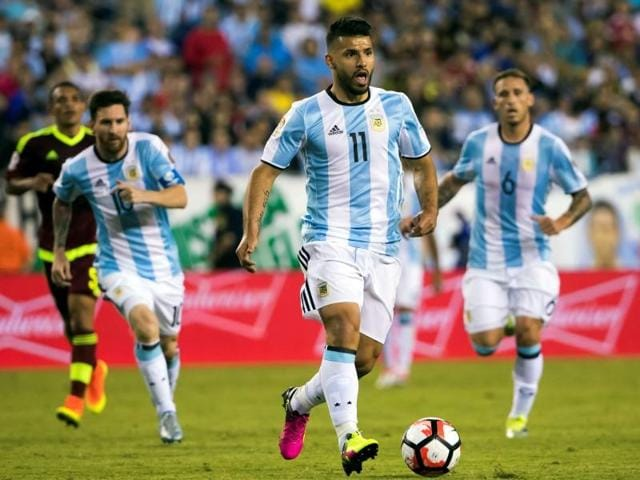 Argentina's Lionel Messi (L) is comforted by teammate Sergio Aguero  after a loss that led one of the best players in the world to retire internationally.