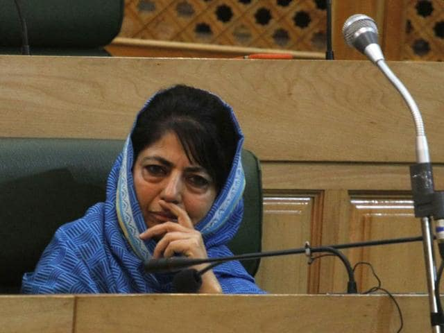 Jammu and Kashmir chief minister Mehbooba Mufti listens to speech of state finance minister Haseeb Drabu  during the budget session in the state assembly.