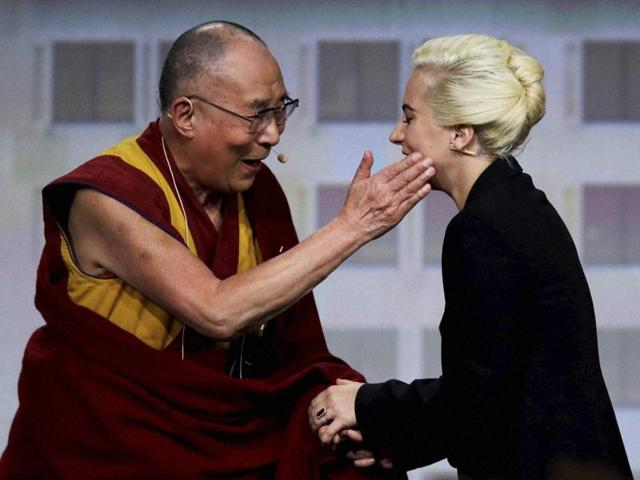 The Dalai Lama greets Lady Gaga before a question and answer session at the US Conference of Mayors in Indianapolis on Sunday.
