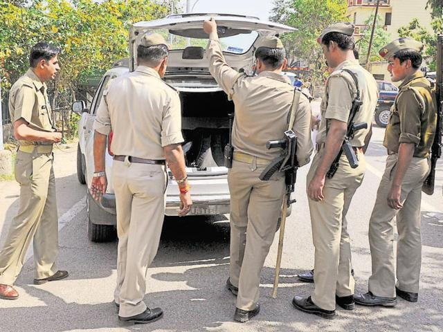 The police team found the cartons stashed in the boot and the rear of the car.