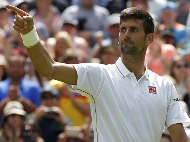 Serbia's Novak Djokovic celebrates winning his match against Great Britain's James Ward.