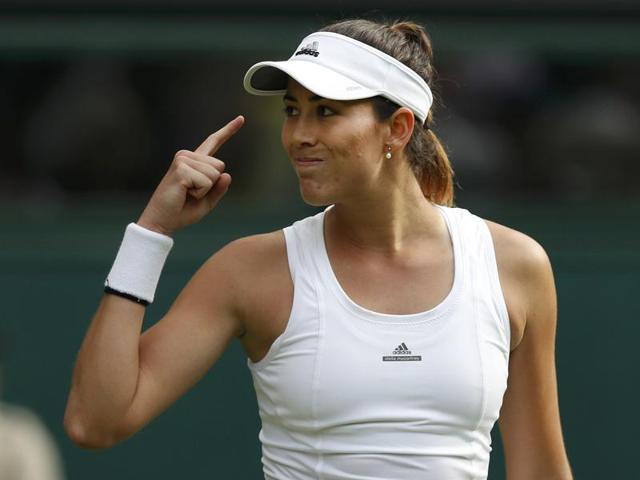 Garbine Muguruza of Spain plays a return to Camila Giorgi of Italy during their women's singles match.