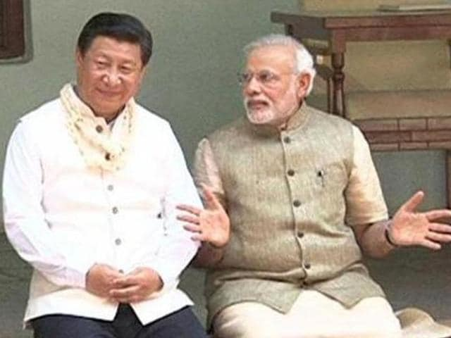 File photo of Chinese President Xi Jinping and Indian Prime Minister Narendra Modi  in Ahmedabad.  China has said that border dispute is a major challenge for bilateral ties between the two countries.