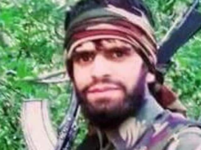 A month after the confusion over the arrest of Hizb militant Tariq Pandit (in pic), the poster in Urdu said that the militant had surrendered and was involved in the killing of two commanders, Naseer Pandit and Waseem Malla.(HT Photo)